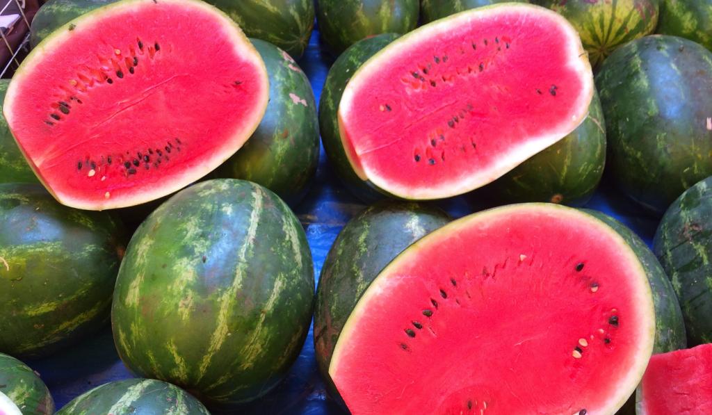 Three watermelons cut in half