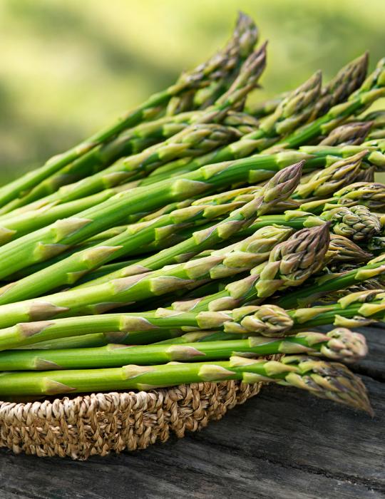 asparagus on a wooden bowl