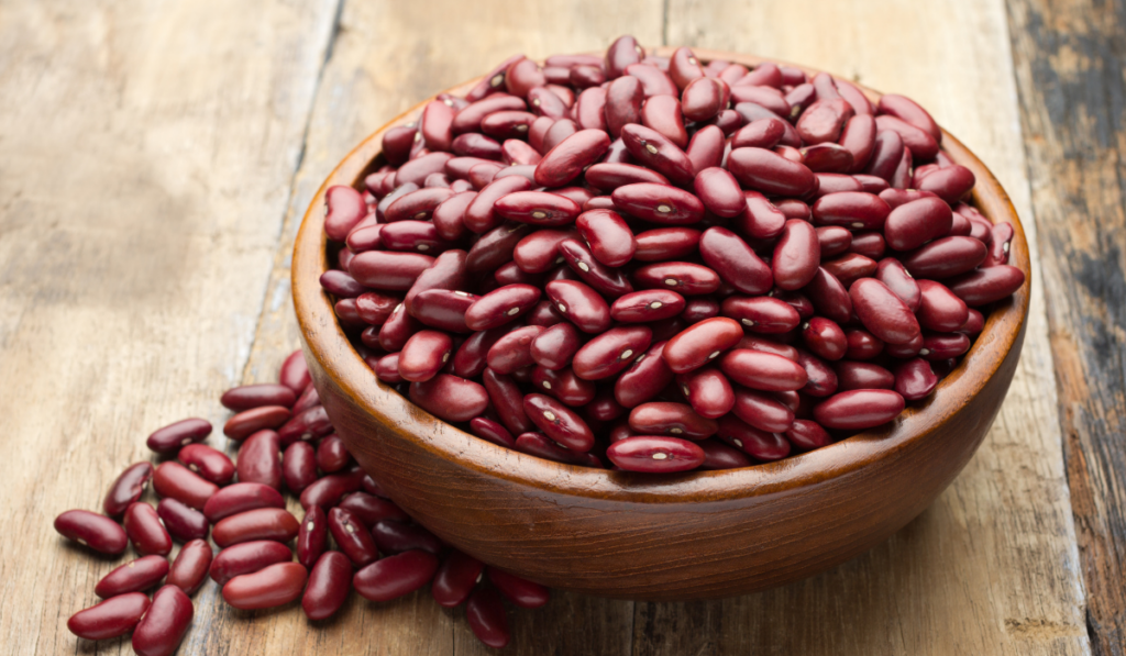 Red beans on a wooden bowl