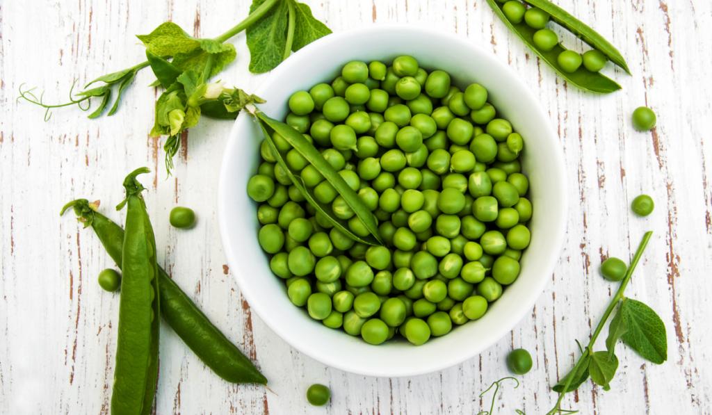 green peas on white bowl