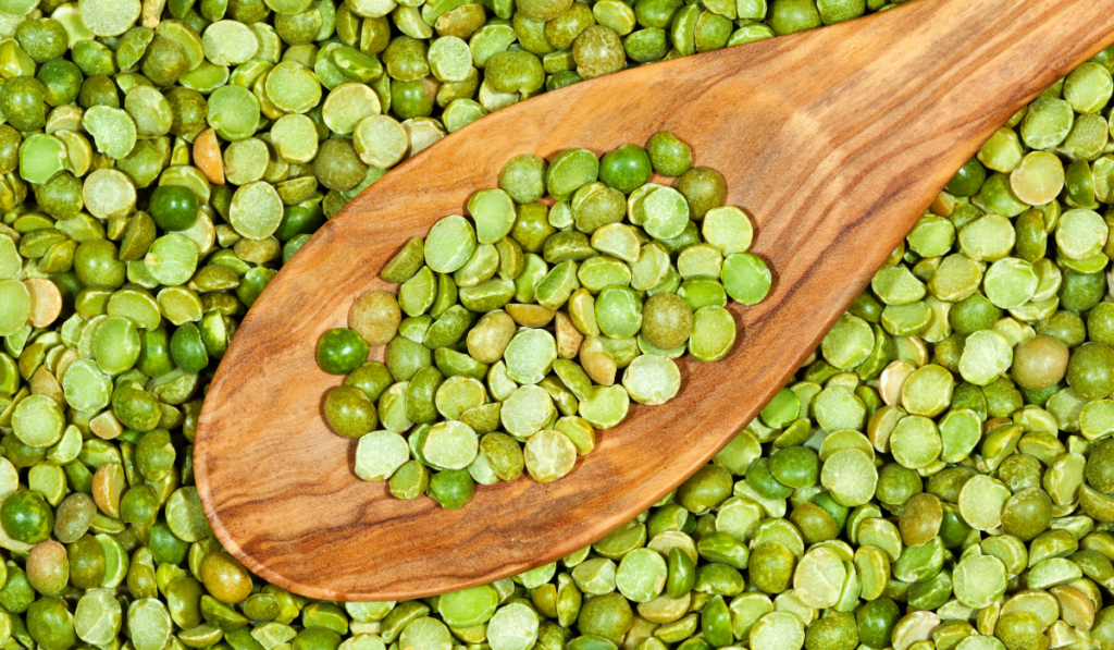 Slice peas with a wooden spoon over it.